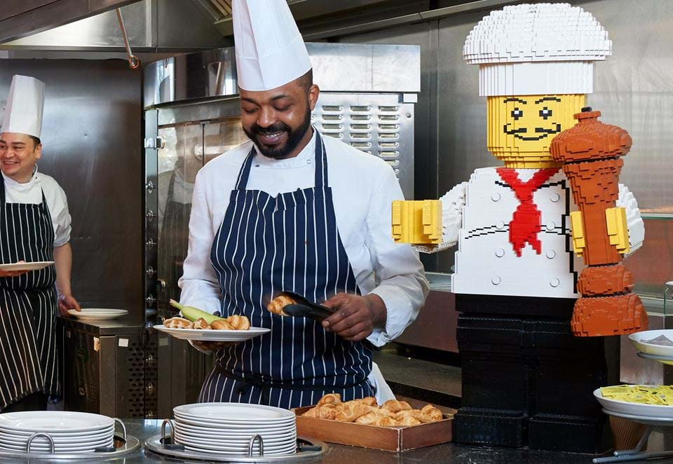 A chef serving food with LEGO chef