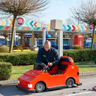 Man servicing a LEGO car