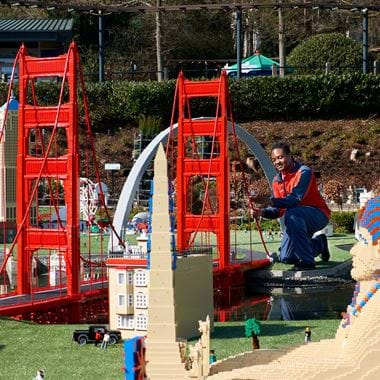 Large LEGO bridge with sphinx in foreground