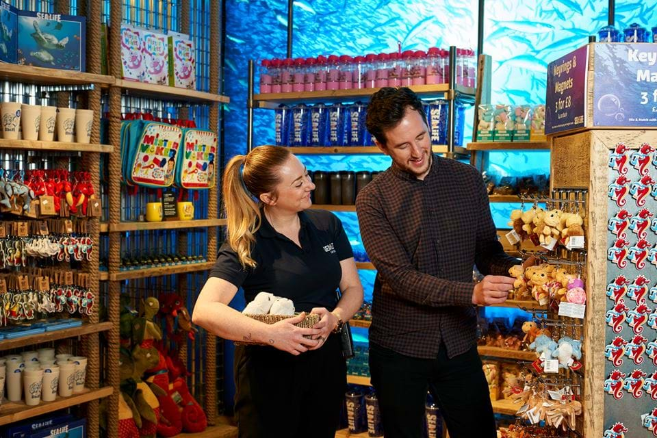 SEALIFE staff helping in gift shop